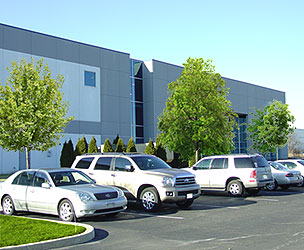 An exterior photograph of the 24 Engelhard Drive parking lot