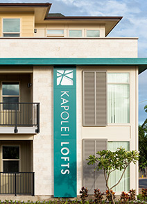 A photograph of exterior signage on the Kapolei Lofts property