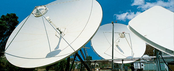 Photograph of satellite dishes at telecommunications
