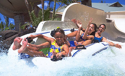 A family enjoying a waterslide at Wet'n'wild, Kapolei